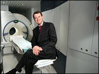 Professor Dudley Pennell with the MRI machine