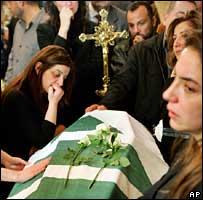 Mourners gather around Pierre Gemayel's coffin in his home village