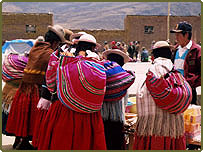 Women in traditional clothes at a market in Bolivia