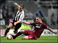 Kevin Nolan (right) tackles Scott Parker