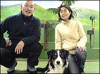 Daisuke Takanami (left), Noriko Mizutani and Ben the sheepdog