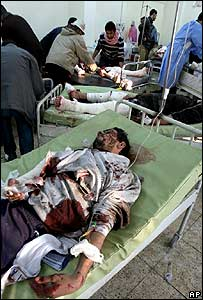 Injured people in a Baghdad hospital after a bomb attack on 12 December