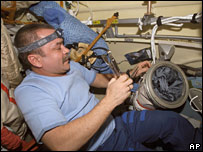 Cosmonaut Mikhail Tyurin working inside the International Space Station