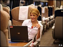 Woman uses a laptop on a train