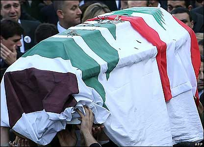 Lebanese mourners carry the coffin of Pierre Gemayel from his village Bikfaya to Beirut