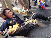 Tibetan protester with his clothes on fire