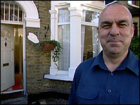 Barry Burke outside his house in east London
