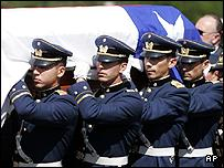 Honour guard soldiers carry the casket of General Pinochet