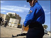 Iraqi policeman guarding ministry building