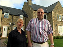 Martin and Debra Bell outside their house in Northumberland