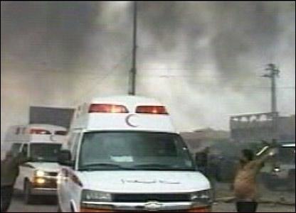 An ambulance amid thick smoke in Sadr City