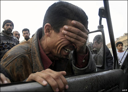 An Iraqi man weeps at the site of the minibus shootings