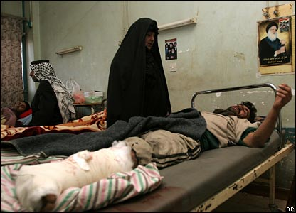 Injured Iraqis lie in hospital beds after the minibus shootings
