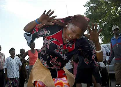 Botswana's San woman celebrates after hearing the final verdict in Lobatse, Botswana