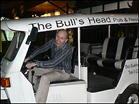 Billy Brunsdon in his pub's 'tuk-tuk'