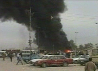 Black smoke rises from a burning car in Sadr City