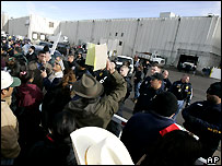Workers' families and police outside meat-packing plant 12 Dec
