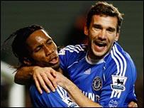 Chelsea goal hero Didier Drogba celebrates with Andriy Shevchenko