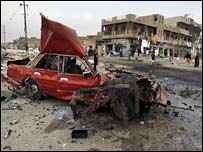 A car destroyed by a bomb in Sadr City