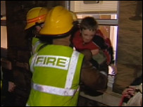 Firefighters rescuing a boy