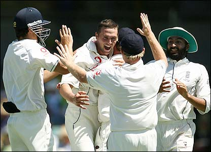 Harmison is congratulated by his England team-mates after