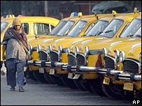 A man walks past parked taxis during the industrial strike in Calcutta, India