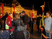 Monarchists gather outside the Royal Palace in Brussels with Belgian flags
