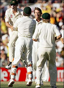 McGrath is congratulated by his Australian team-mates