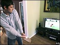 Man playing golf on Nintendo Wii