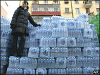Harbin resident with a stack of bottled water