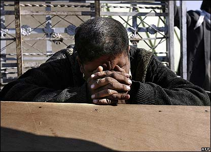 A man grieves over a coffin in Baghdad