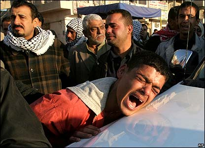 A mourner weeps during a funeral procession