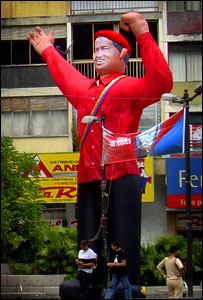 An giant inflatable doll of Chavez by a campaign stall in Caracas