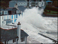 A wave hitting a sea wall (Image: PA)