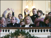 Supporters wave from the gallery as the civil unions bill is debated in the New Jersey Assembly