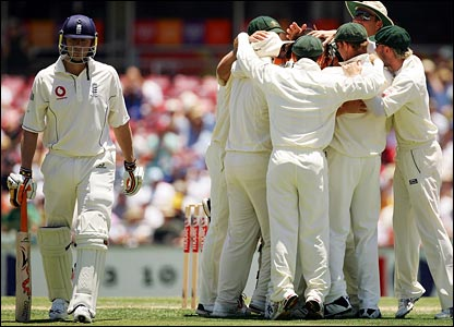Andrew Flintoff begins his journey to the dressing room as Australia celebrate