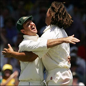 Symonds is congratulated by captain Ricky Ponting