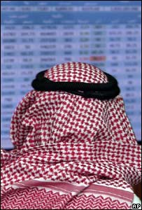 Saudi man watching market trading screen