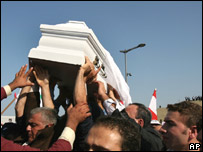 Mr Gemayel's coffin is carried along the streets of Beirut