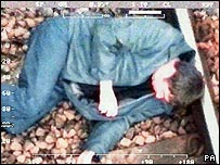 Kevin Craswell, 48, asleep on a railway track (British Transport Police/PA)