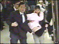 Wu Shu-chen is carried from the courthouse in an image from Taiwan's Set TV station