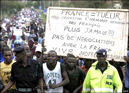 Angry demonstrators in Rwanda on the day a French judge issued warrants for the arrest of nine aides of the Rwandan leader over his predecessor's killing - which sparked the genocide.