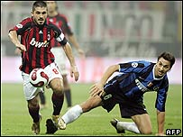 AC Milan's midfielder Gennaro Gattuso (L) and Inter Milan's forward Zlatan Ibrahimovic