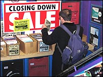 Customer browsing through Beanos' sale items