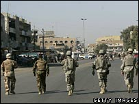 US soldiers walk toward the scene of a mortar attack in the Kadhimiyah district of Baghdad