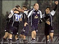 Bristol celebrate the late kick of Jason Strange (number 21)