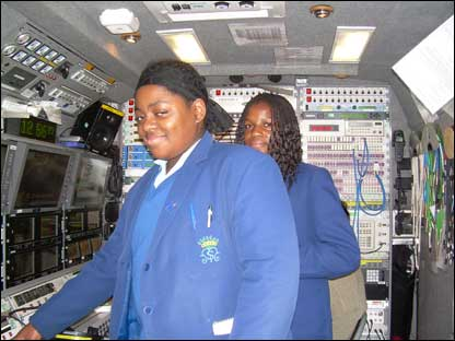 Ebony, 13, and Laura, 12, inside the BBC broadcast truck