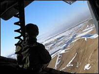 A German soldier stares out over Afghanistan from a military helicopter