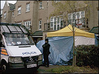 Police stand outside the residence of Alexander Litvinenko