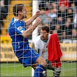 Everton's James Beattie celebrates an own goal by Charlton's Hermann Hreidarsson